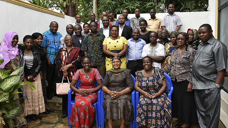 Group photo of the workshop participant, from Left Sitting Project Officer Hanns Seidel Foundation Ms. Kadele Mabumba, Handeni District Commissioner Ms. Husna Msangi. and Handeni Acting Director Ms. Zawadi Ngendo